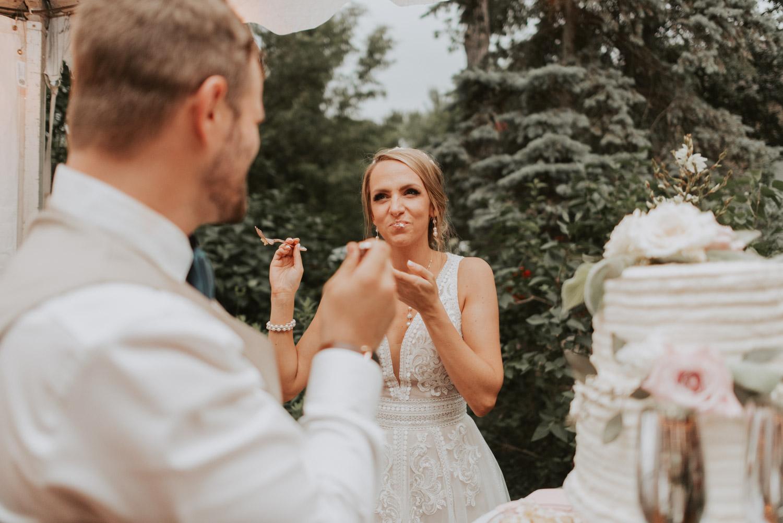 bride and groom cake cuttingat reception at wedding in lincoln, nebraska