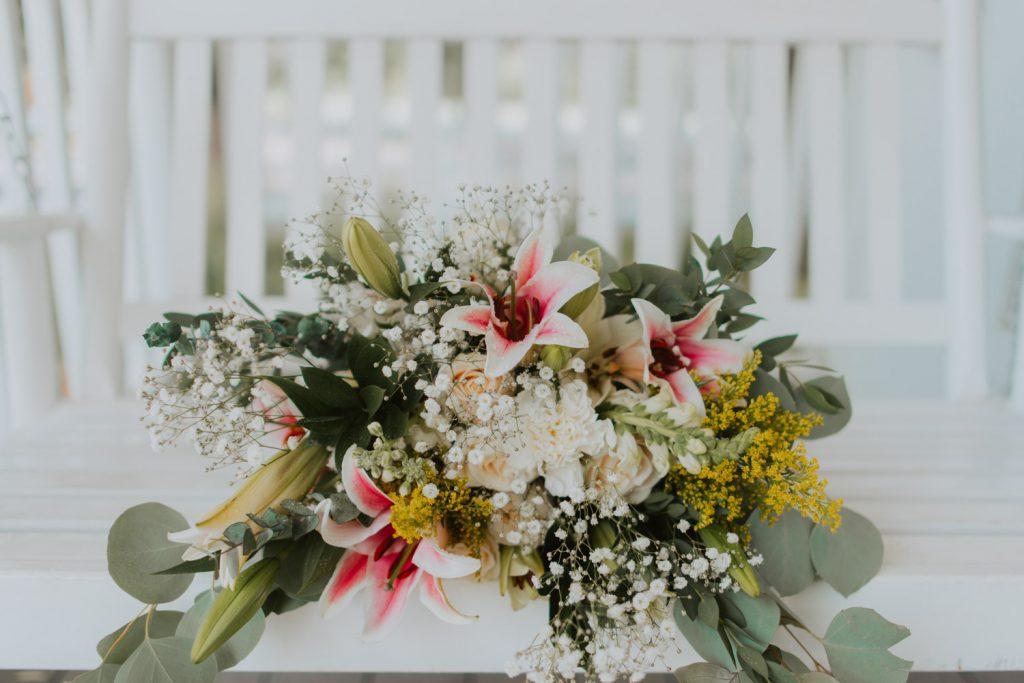 bridal floral bouquet photos from wedding reception at the barn at raccoon creek in ken caryl denver colorado