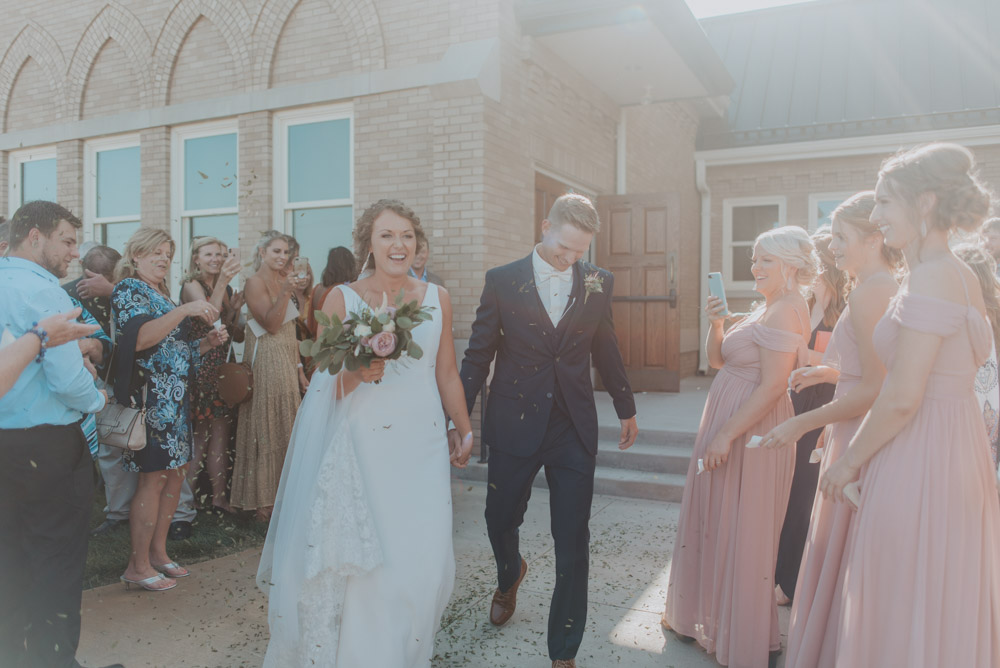 bride and groom formal exit for wedding ceremony in pickerell-lincoln nebraska