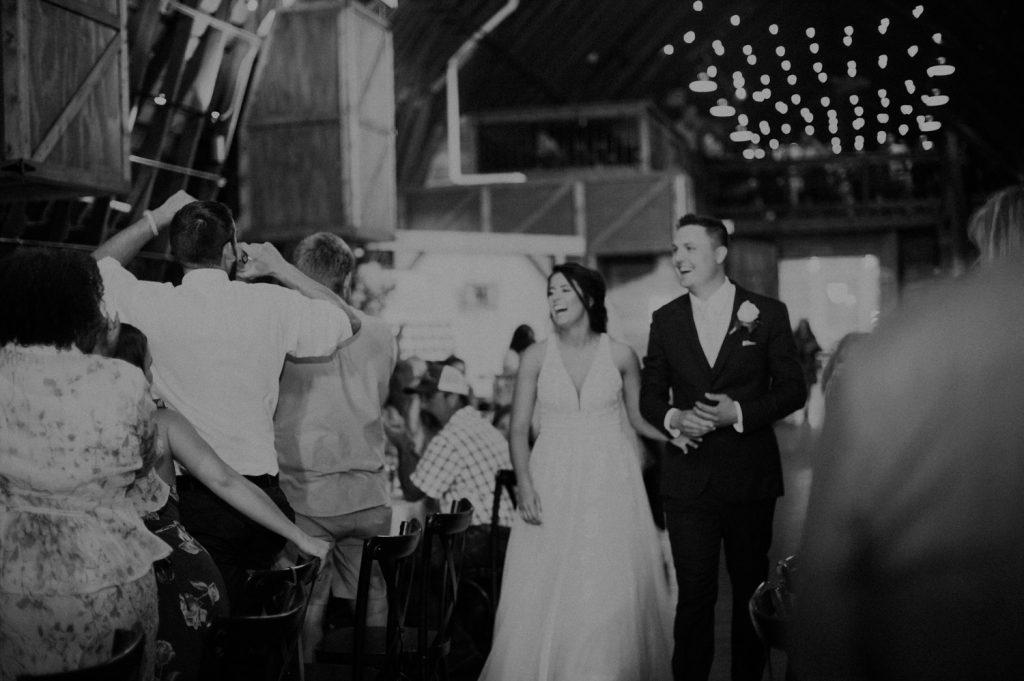 bride and groom at reception at ackerhurst barn in omaha, nebraska