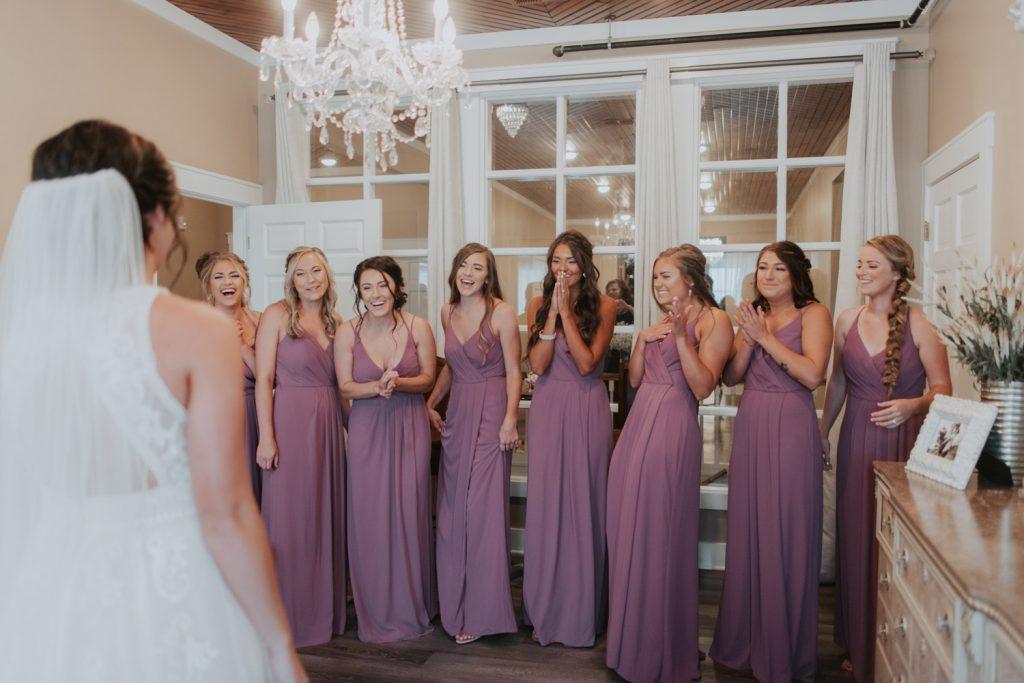bridesmaids first look from wedding details at ackerhurst barn wedding in omaha, nebraska