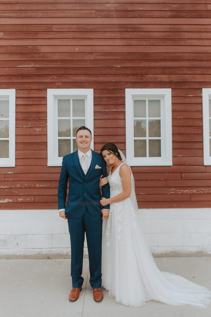 bride and groom first look from ackerhurst barn wedding in omaha, nebraska