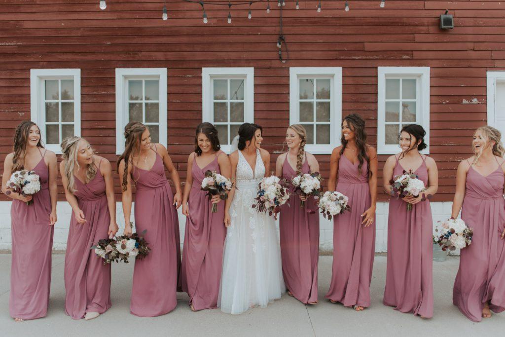 bride and bridesmaids from ackerhurst barn wedding in omaha, nebraska