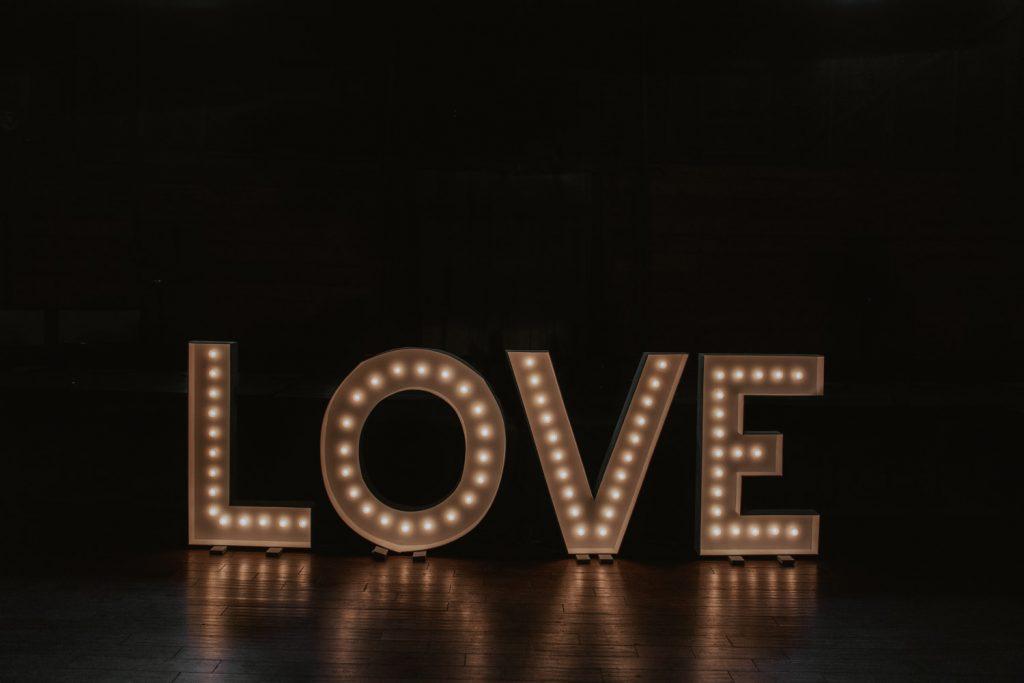 LOVE light up sign from wedding in ackerhurst barn in omaha, nebraska