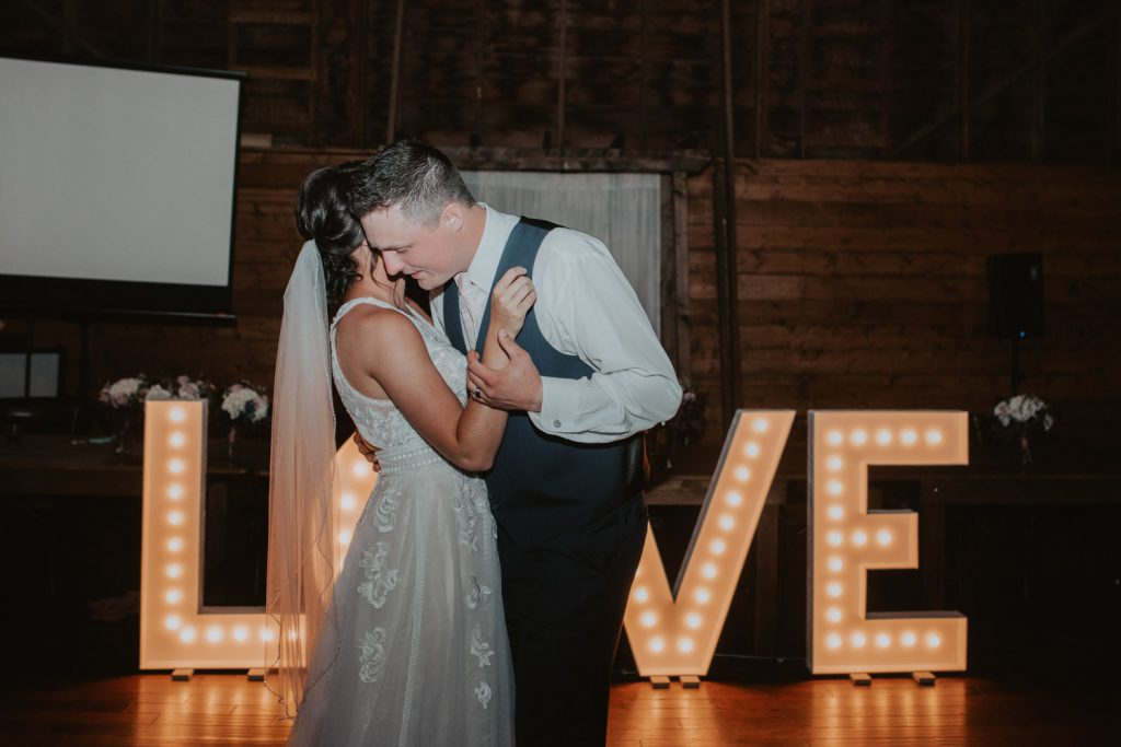 bride and groom first dance at ackerhurst barn in omaha, nebraska