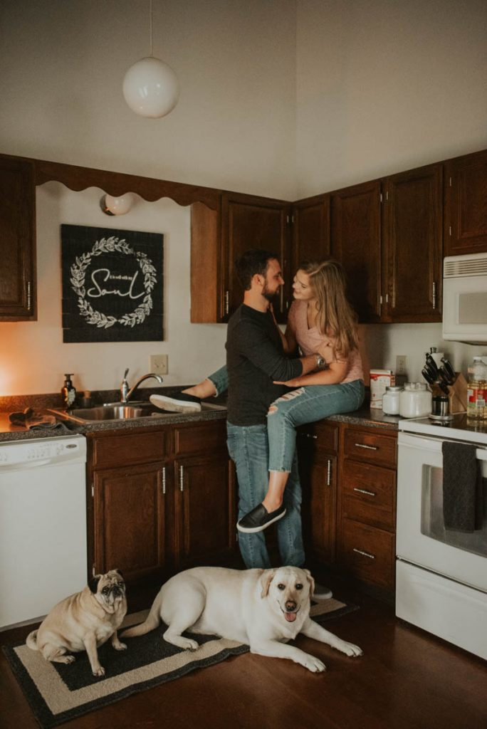 couples engagement in-home session with dogs