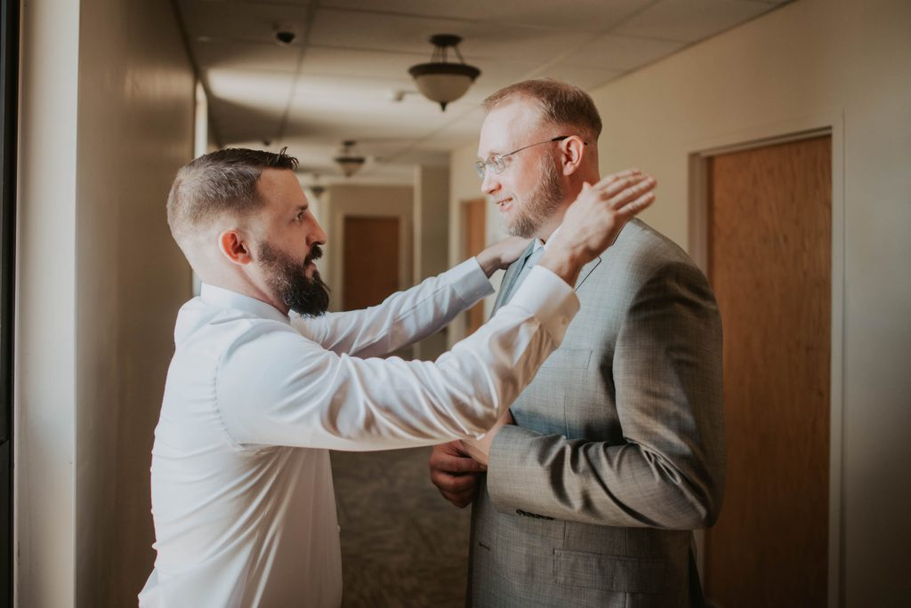 getting ready moments from wedding ceremony at st. francis of assisi in castle rock colorado