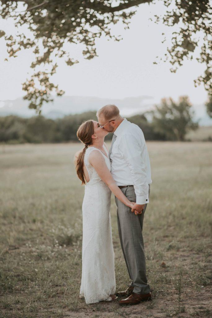 bride and groom portraits from fall barn wedding in sedalia colorado