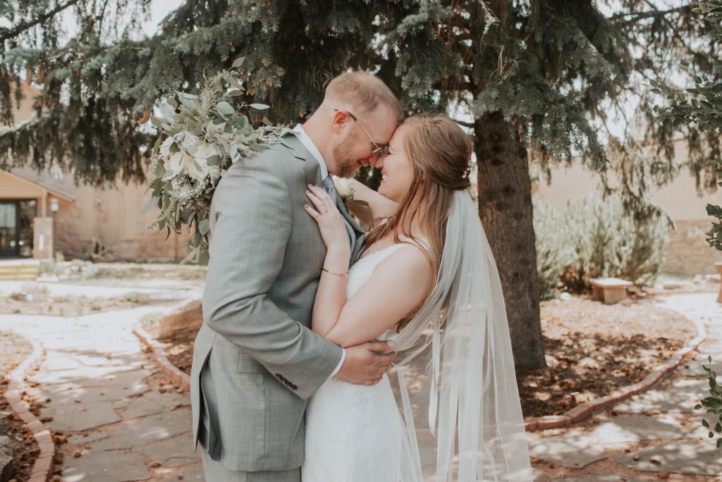 bride and groom from wedding ceremony at st. francis of assisi in castle rock colorado