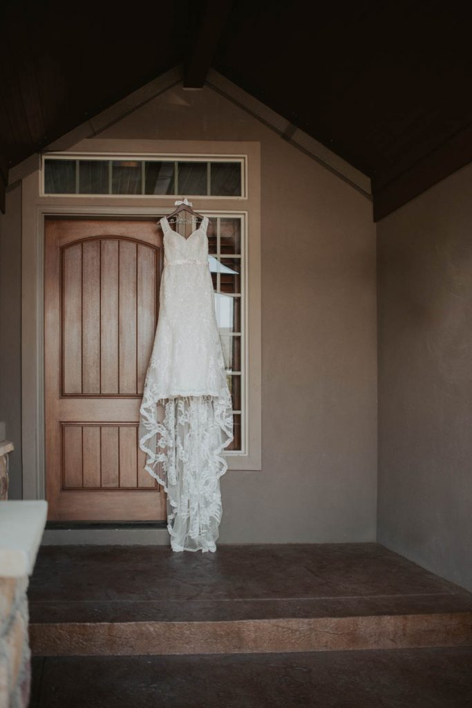 wedding dress hanging from wedding at horsetooth in fort collins colorado