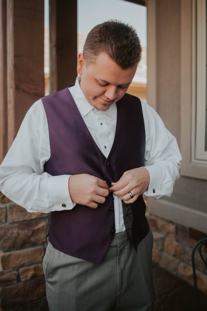 groom getting ready from wedding at horsetooth in fort collins colorado