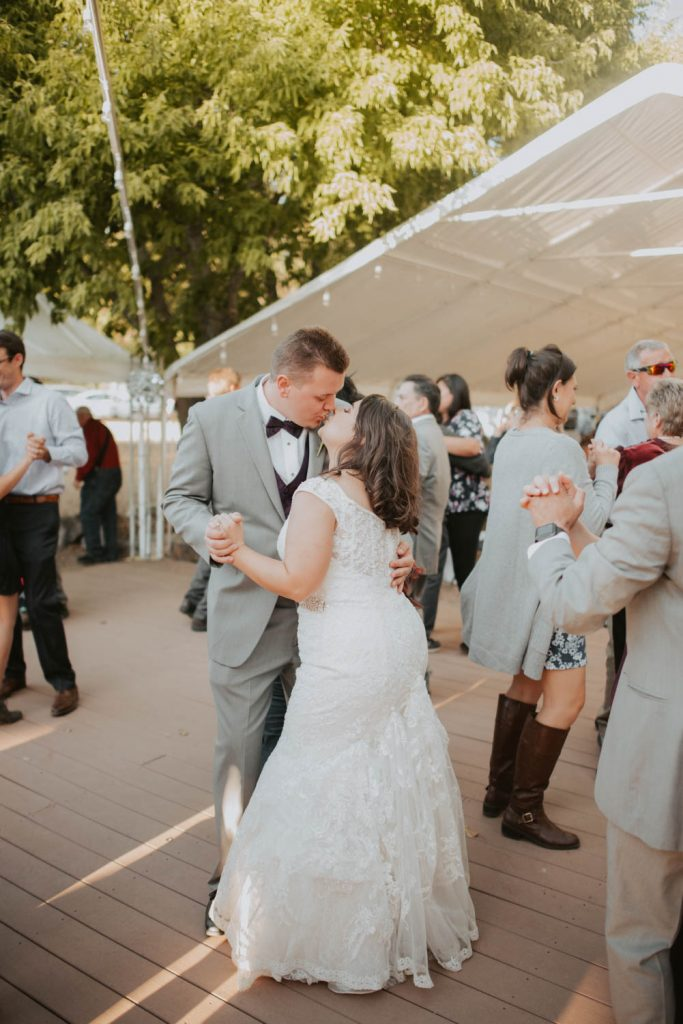 bride and groom on the dance floor from wedding at horsetooth in fort collins colorado