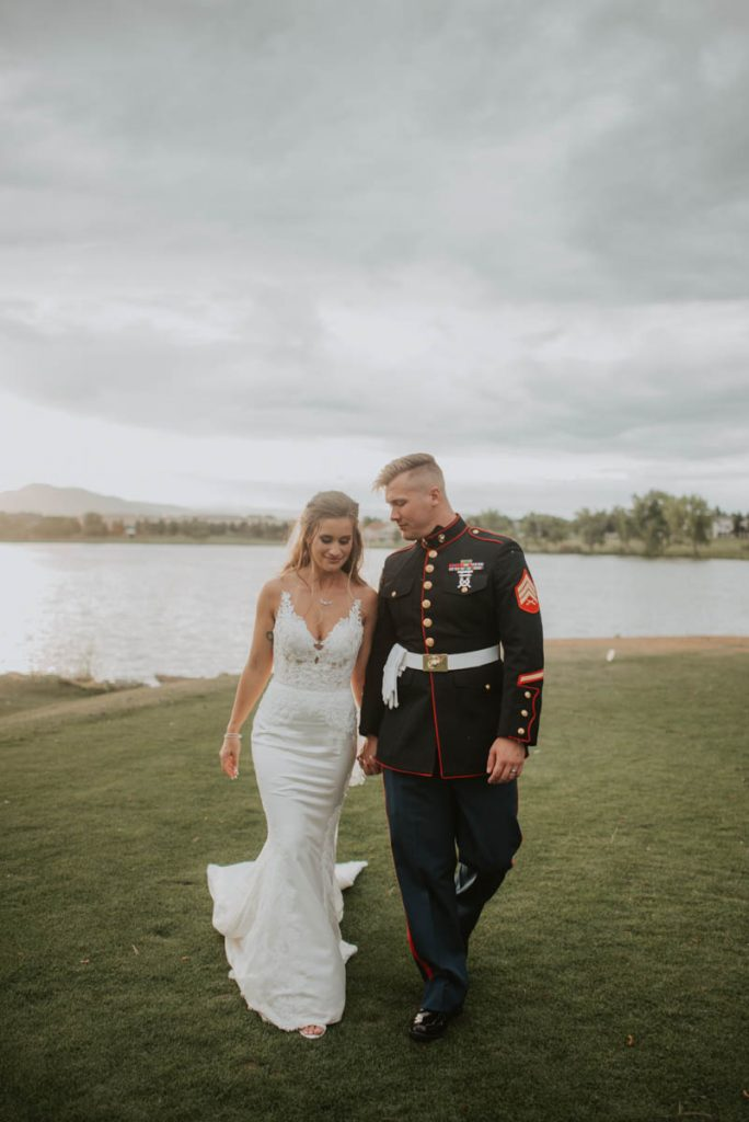 bride and groom on 17th hole at raccoon creek in littleton colorado