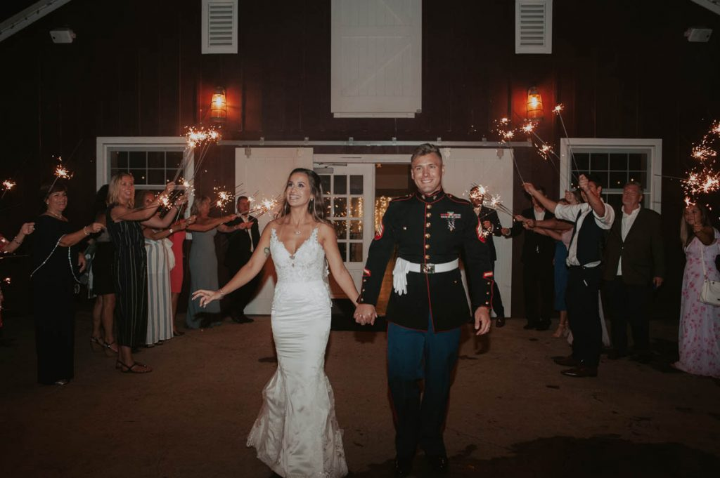 bride and groom final exit from wedding at raccoon creek in littleton colorado