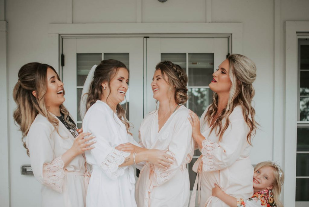 bridesmaids getting ready from wedding at raccoon creek in littleton colorado