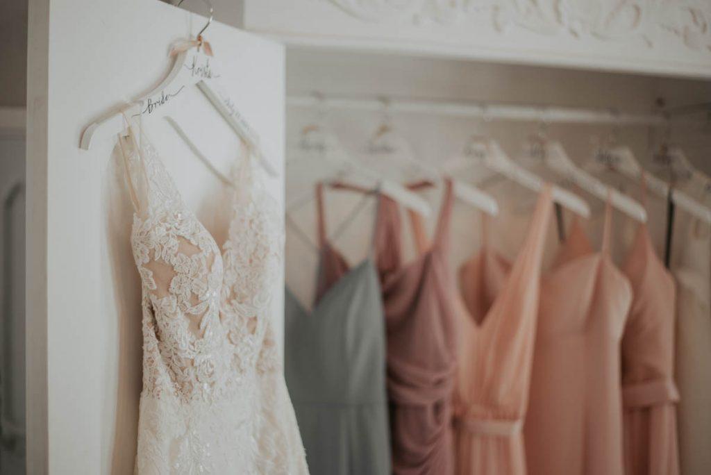 bridesmaids dress in closet from wedding at raccoon creek in littleton colorado