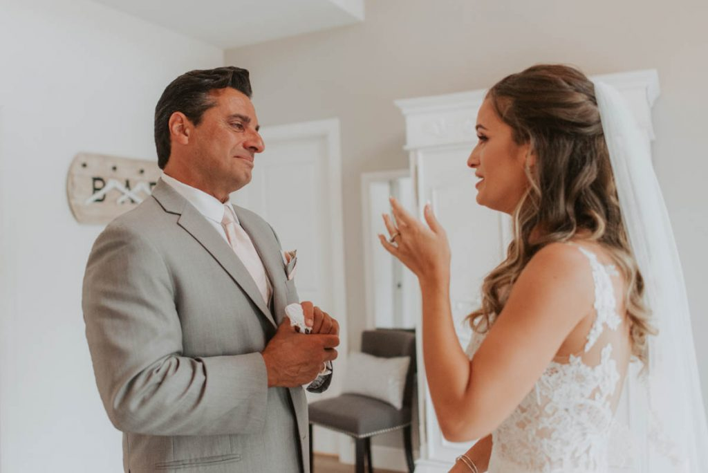 bride and father first look from wedding at raccoon creek in littleton colorado