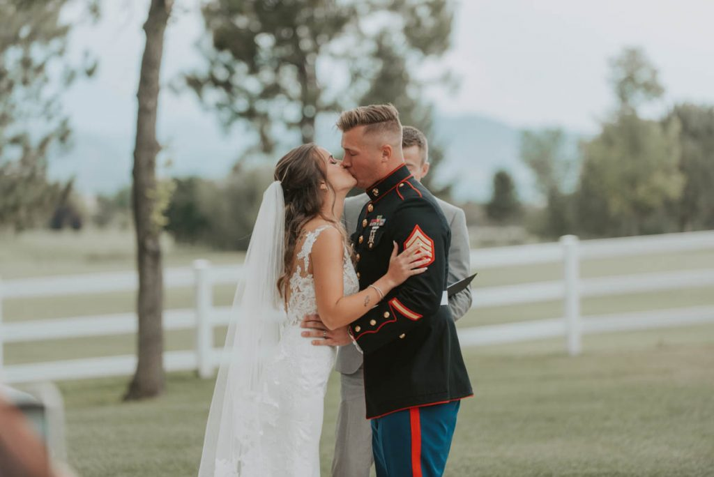wedding ceremony first kiss at raccoon creek in littleton colorado