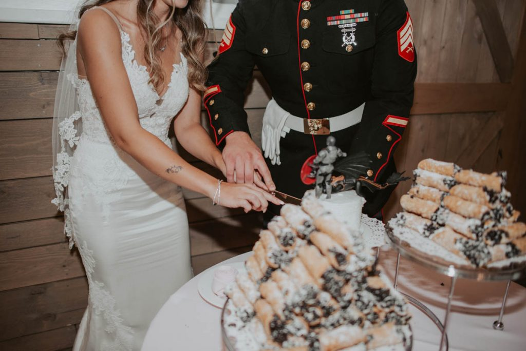 bride and groom cake cutting from wedding at raccoon creek in littleton colorado