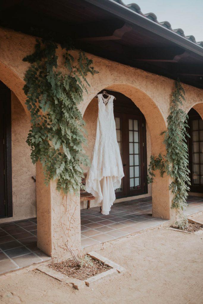 wedding dress hanging from wedding at villa parker in denver colorado