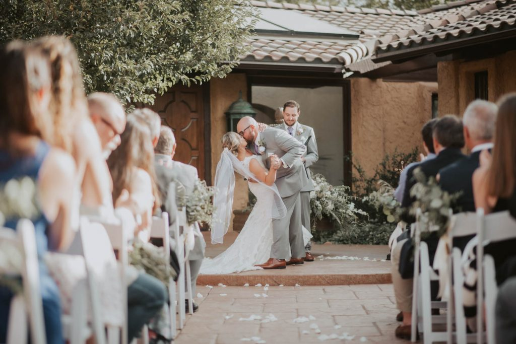 bride and groom first kiss from wedding at villa parker in denver colorado