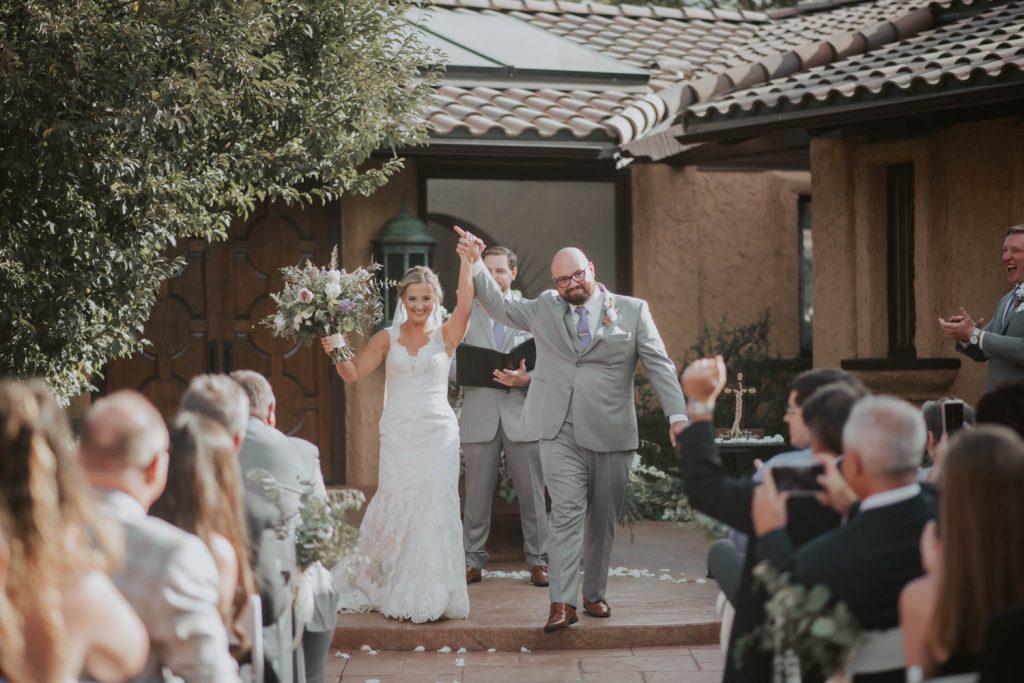 bride and groom at ceremony from wedding at villa parker in denver colorado
