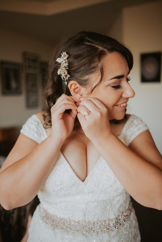 bride getting ready wedding at horsetooth reservoir in fort collins colorado