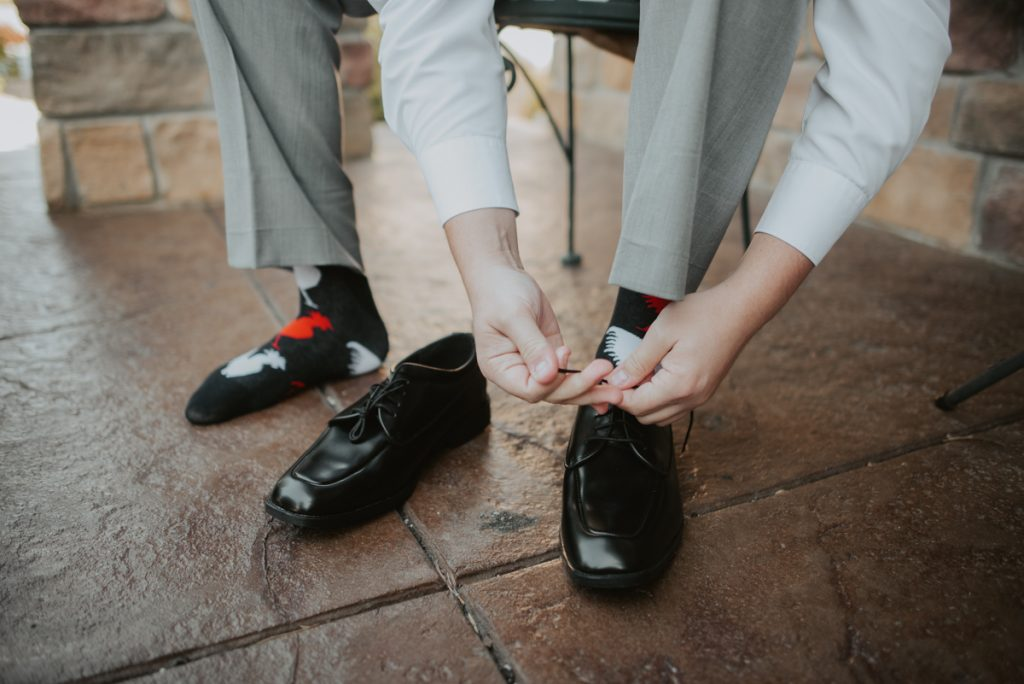 groom getting ready at wedding at horsetooth reservoir in fort collins colorado