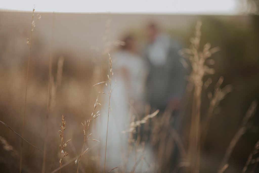 bride and groom sunset photos at wedding at horsetooth reservoir in fort collins colorado