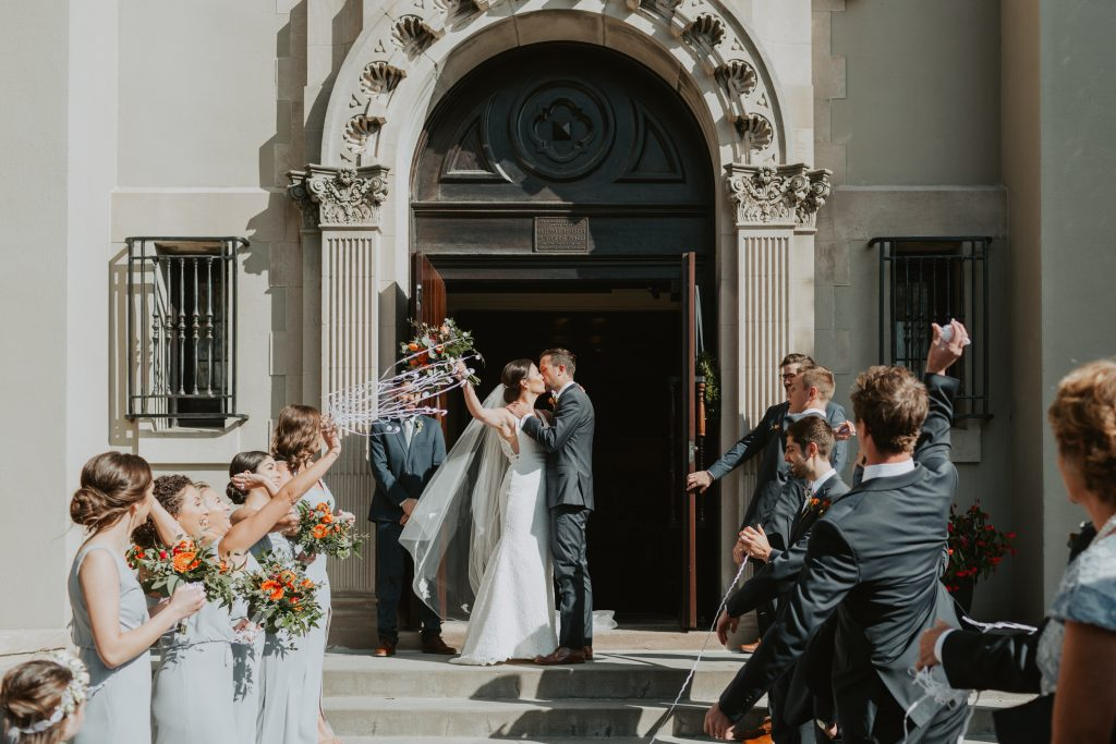 bride and groom confetti exit at wedding ceremony at st francis cabrini church