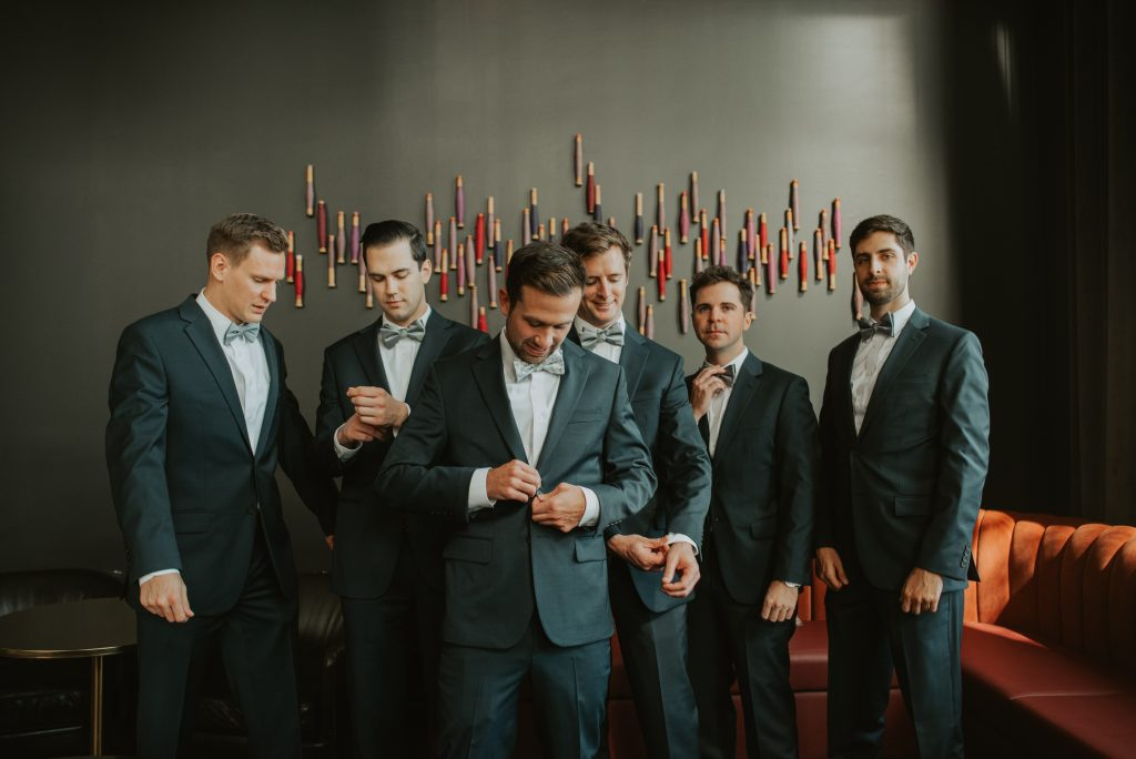 groomsmen getting ready at hotel deco in omaha nebraska