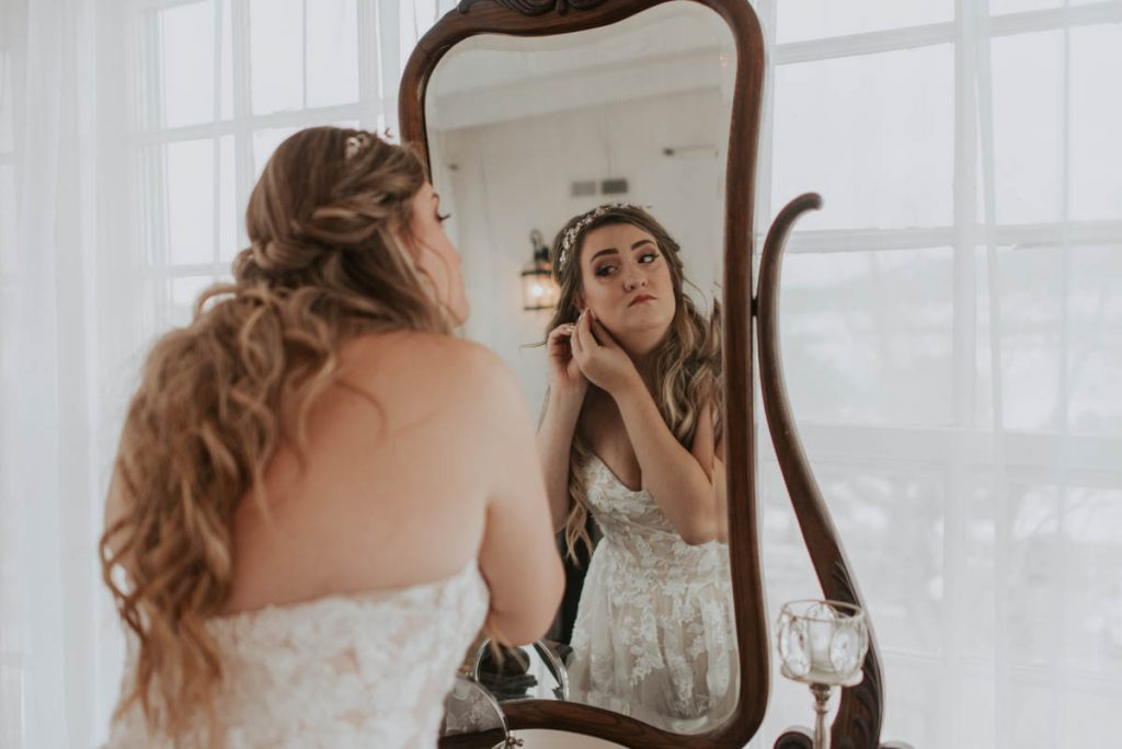 bride getting ready at wedding in littleton colorado at manor house