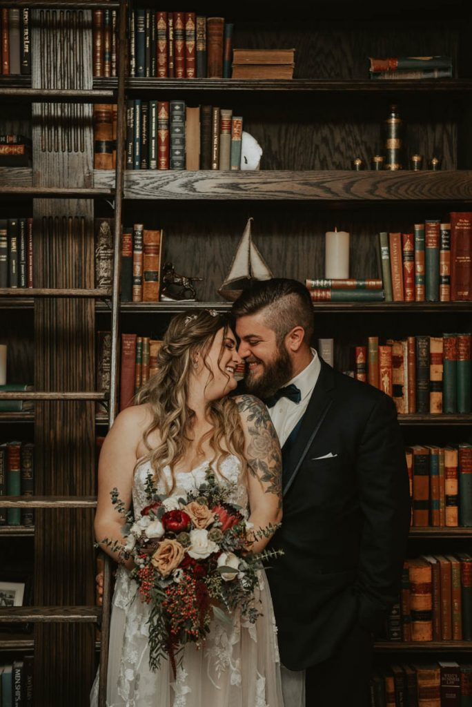 bride and groom in the library at wedding in littleton colorado at manor house